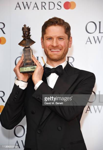 Kyle Soller winner of the Best Actor award for 'The Inheritance' poses in the press room at The Olivier Awards 2019 with Mastercard at The Royal...