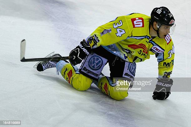 Kyle Sonnenburg of Krefeld Pinguine knees on the ice during the fifth DEL PlayOffmatch between Krefeld Pinguine and ERC Ingolstadt at Koenigspalast...