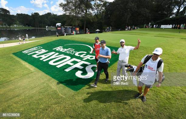 Kyle Stanley and Adam Hadwin walk along the 15th hole during the first round of the TOUR Championship the final event of the FedExCup Playoffs at...