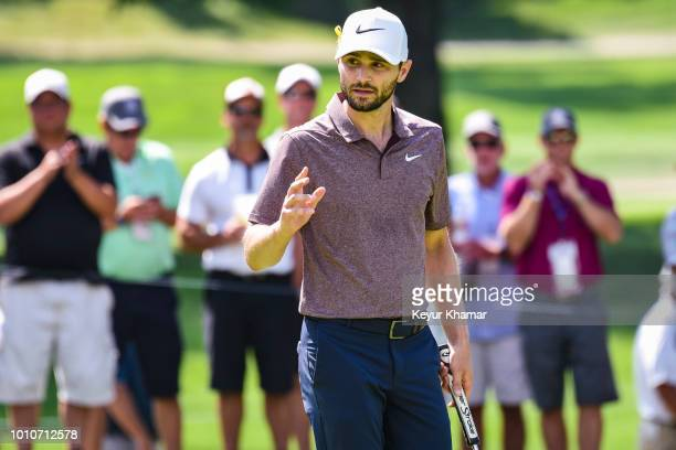 Kyle Stanley celebrates and waves to fans after making a birdie on the 11th hole green during the second round of the World Golf...