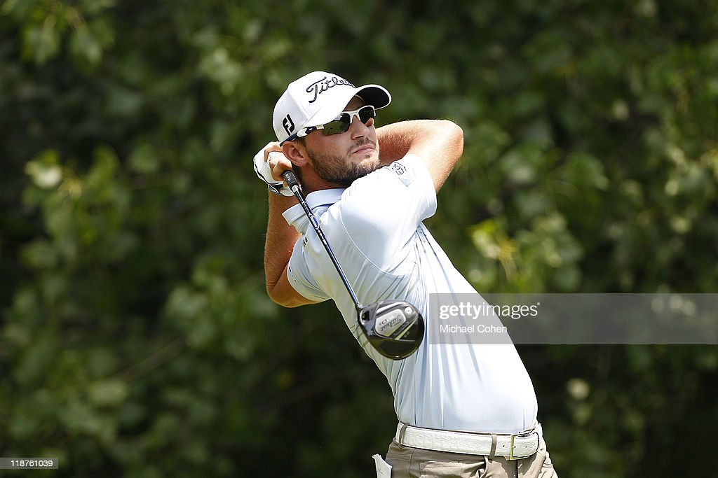 Kyle Stanley hits his drive on the second hole during the final round of the John Deere Classic at TPC Deere Run on July 10, 2011 in Silvis, Illinois.