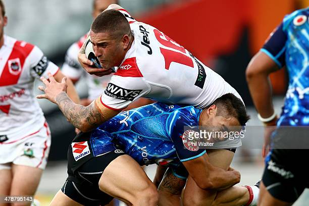 Kyle Stanley of St George is tackled by Shaun Johnson of the Warriors during the round two NRL match between the New Zealand Warriors and the St...