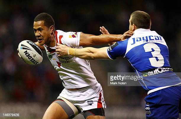 Kyle Stanley of the Dragons is tackled by Josh Morris of the Bulldogs during the round 15 NRL match between the St George Illawarra Dragons and the...