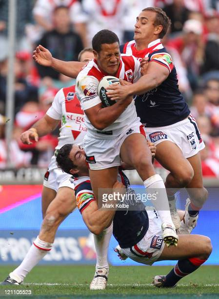 Kyle Stanley of the Dragons is tackled during the round 23 NRL match between the St George Illawarra Dragons and the Sydney Roosters at WIN Stadium...