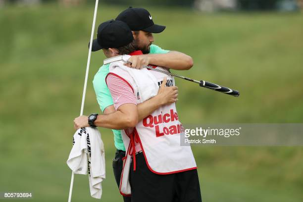 Kyle Stanley of the United States celebrates with his caddie Brian Reed after defeating Charles Howell III of the United States during a playoff in...