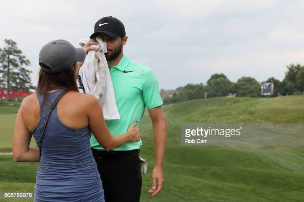 Kyle Stanley of the United States celebrates with his wife Dolly after defeating Charles Howell III of the United States during a playoff in the...