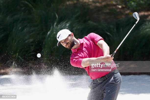 Kyle Stanley of the United States plays a shot from a bunker on the first hole during the final round of THE PLAYERS Championship at the Stadium...