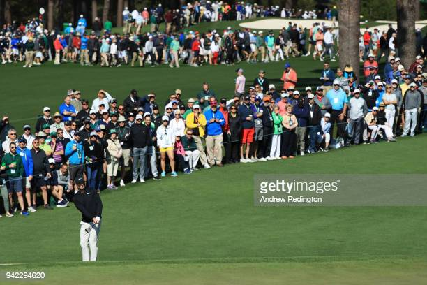 Kyle Stanley of the United States plays a shot on the second hole as a gallery of patrons look on during the first round of the 2018 Masters...