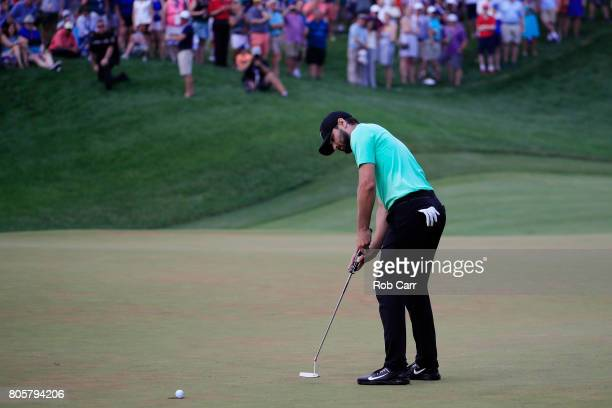 Kyle Stanley of the United States putts on the 18th green during a playoff in the final round of the Quicken Loans National on July 2 2017 TPC...