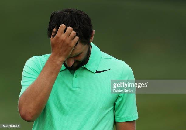 Kyle Stanley of the United States reacts after defeating Charles Howell III of the United States during a playoff in the final round of the Quicken...