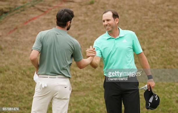 Kyle Stanley of the United States shakes hands with Sergio Garcia of Spain after defeating him 31 on the 17th green during the fourth round of the...