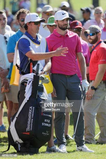 Kyle Stanley of the United States talks with his caddie Brian Reed during the final round of THE PLAYERS Championship at the Stadium course at TPC...