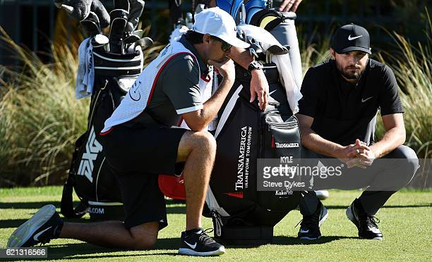 Kyle Stanley of the United States talks with his caddie on the third tee during the third round of the Shriners Hospitals For Children Open on...