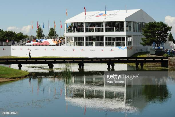 Kyle Stanley of the United States walks over the bridge from the 18th green during the second round of the CJ Cup at Nine Bridges on October 20 2017...