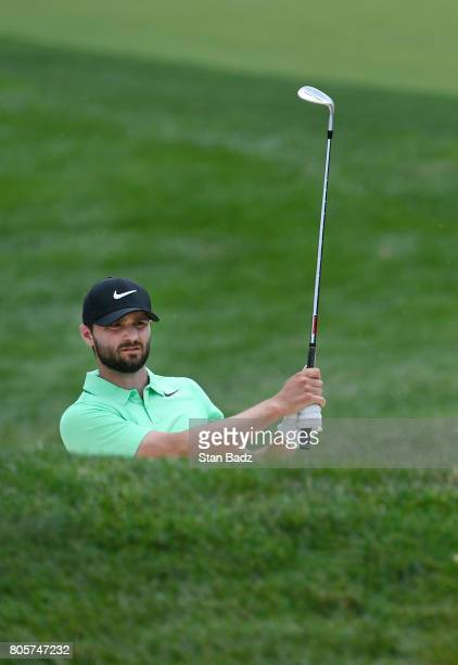 Kyle Stanley plays a bunker shot on the first hole during the final round of the Quicken Loans National at TPC Potomac at Avenel Farm on July 2 2017...