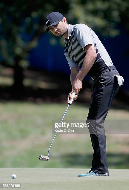 Kyle Stanley putts on the first hole during the final round of the Wyndham Championship at Sedgefield Country Club on August 21 2016 in Greensboro...