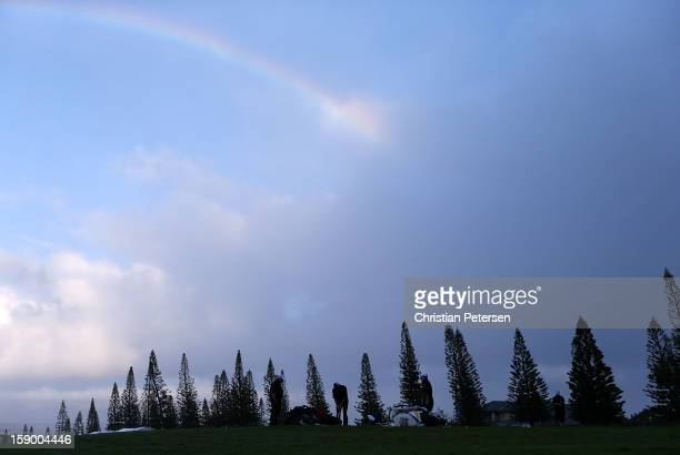 Kyle Stanley putts on the practice green under a rainbow during a weather delay before the replay of the first round of the Hyundai Tournament of...