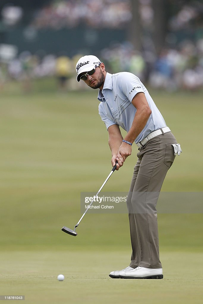 Kyle Stanley strokes his putt for birdie on the 17th green during the final round of the John Deere Classic at TPC Deere Run on July 10, 2011 in Silvis, Illinois.