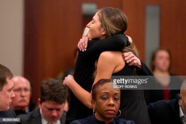 Kyle Stephens a victim of former Team USA doctor Larry Nassar gets a hug following her victim impact statement during a sentencing hearing in Lansing...
