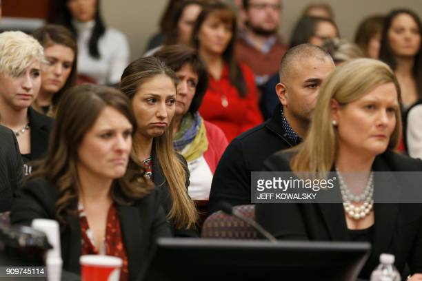 Kyle Stephens and other people react as former Michigan State University and USA Gymnastics doctor Larry Nassar listens to impact statements during...