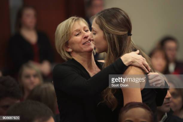 Kyle Stephens gets a hug after giving a victims impact statement at the sentencing of Larry Nassar who has been accused of molesting about 100 girls...