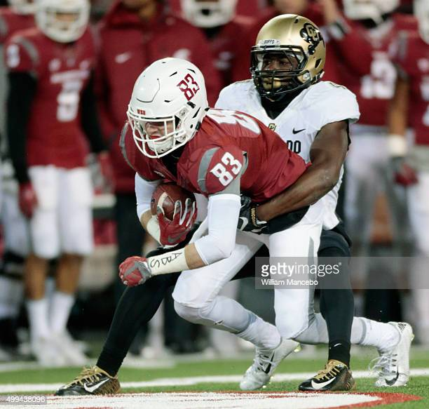 Kyle Sweet of the Washington State Cougars carries the ball against Chidobe Awuzie of the Colorado Buffaloes in the game at Martin Stadium on...
