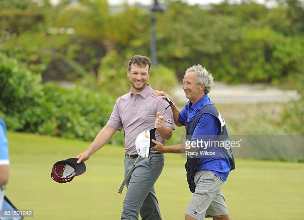 Kyle Thompson and his caddie Tim 'Smiley' Thalmueler celebrate during the final round of The Bahamas Great Exuma Classic at Sandals Emerald Bay...