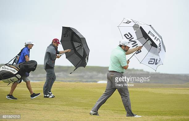 Kyle Thompson and Kent Bulle try to make their way down the 12th fairway during the final round of The Bahamas Great Exuma Classic at Sandals Emerald...