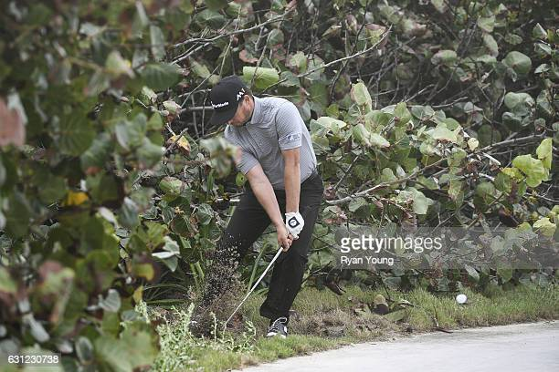 Kyle Thompson punches out from the trees on the 13th hole during the first round of The Bahamas Great Exuma Classic at Sandals Emerald Reef Course on...