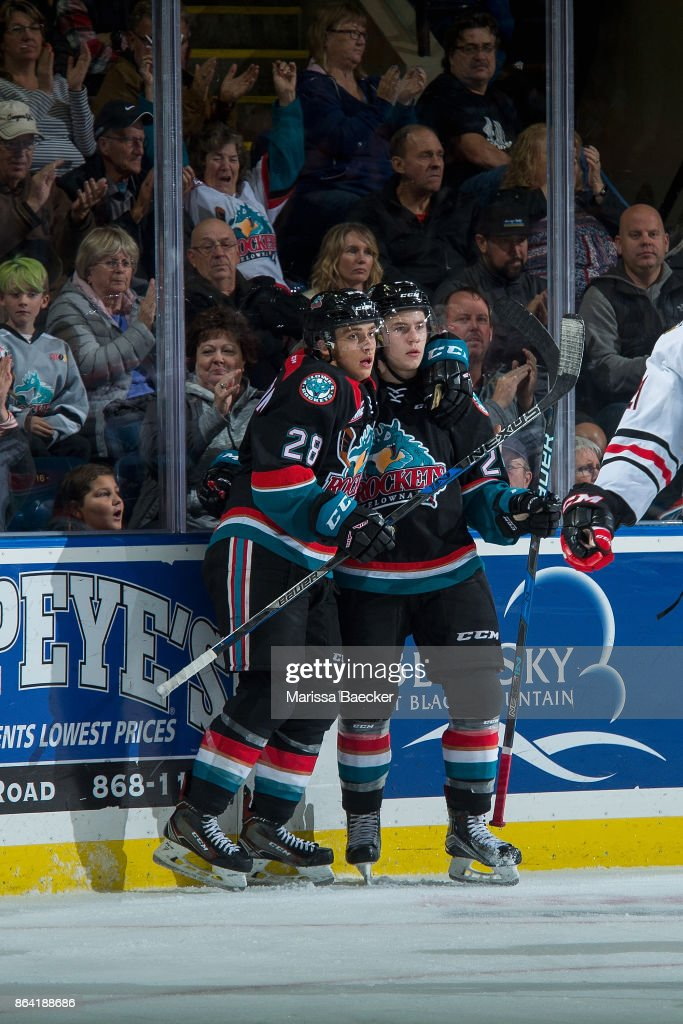 Kyle Topping #24 and Leif Mattson #28 of the Kelowna Rockets celebrate a third period goal against the Portland Winterhawks at Prospera Place on October 20, 2017 in Kelowna, Canada.