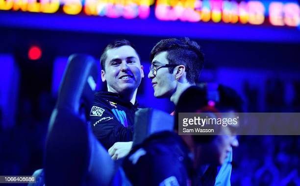 Kyle 'Torment' Storer of team Cloud9 celebrates with teammate Mariano 'SquishyMuffinz' Arruda after they defated team Dignitas in the grand finals...