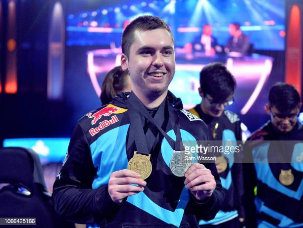 Kyle 'Torment' Storer of team Cloud9 holds up a pair of medals after his team won the grand finals match of the Rocket League Championship Series...
