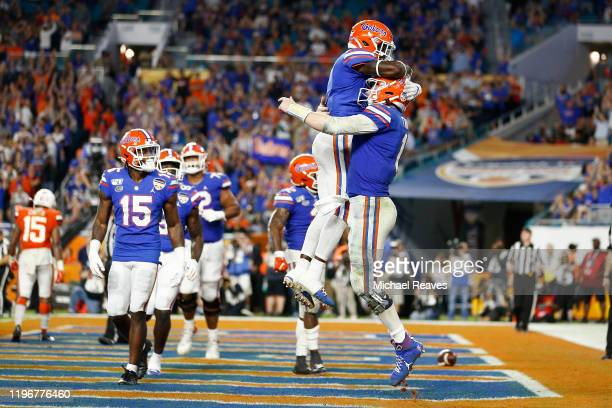 Kyle Trask of the Florida Gators celebrates after scoring a touchdown against the Virginia Cavaliers during the second half of the Capital One Orange...