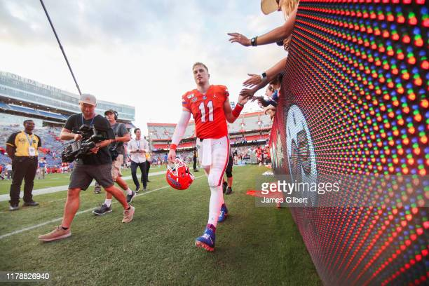 Kyle Trask of the Florida Gators greets fans after a game against the Towson Tigers at Ben Hill Griffin Stadium on September 28 2019 in Gainesville...