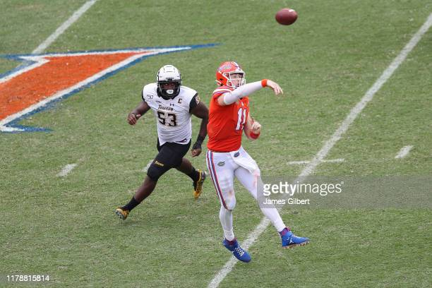 Kyle Trask of the Florida Gators throws a pass after being pressured by Bryce Carter of the Towson Tigers during the third quarter of a game against...
