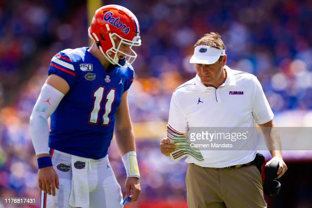 Kyle Trask speaks with head coach Dan Mullen of the Florida Gators during the game against the Tennessee Volunteers at Ben Hill Griffin Stadium on...