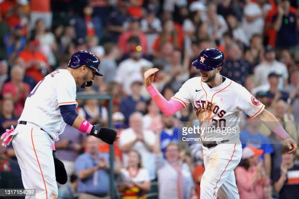 Kyle Tucker of the Houston Astros celebrates with Yuli Gurriel after hitting a three run home run during the fourth inning against the Toronto Blue...