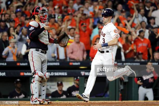 Kyle Tucker of the Houston Astros comes home to score a run on a double by George Springer against the Washington Nationals during the eighth inning...
