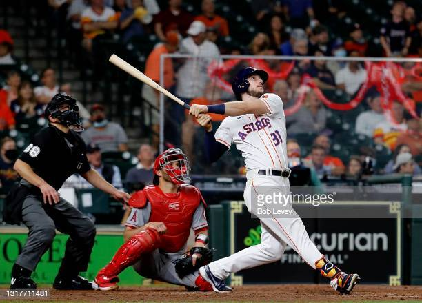 Kyle Tucker of the Houston Astros hits a two-run home run in the sixth inning against the Los Angeles Angels at Minute Maid Park on May 12, 2021 in...