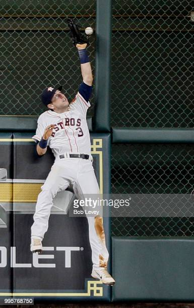 Kyle Tucker of the Houston Astros leaps at the wall but unable to make a catch at the wall on a fly ball by Marcus Semien of the Oakland Athletics in...