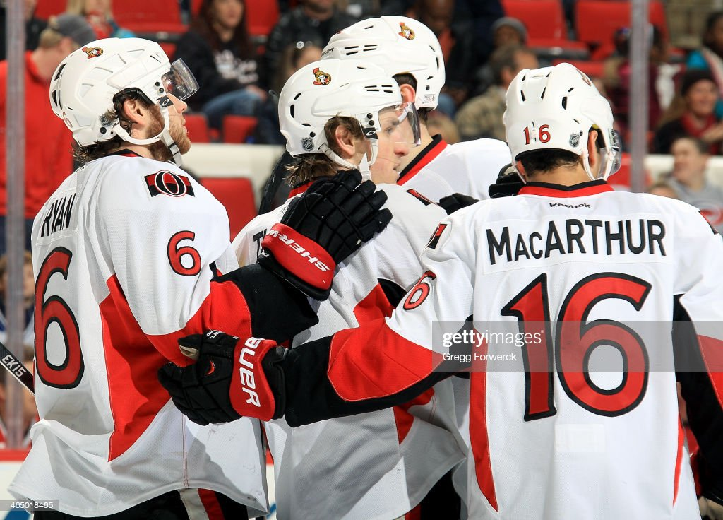 Kyle Turis #7 of the Ottawa Senators celebrates his first goal of the second period against the Carolina Hurricanes with teammates Bobby Ryan #6, Eric Gryba #62 and Clarke MacArthur #16 during their NHL game at PNC Arena on January 25, 2014 in Raleigh, North Carolina.