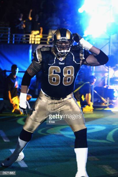 Kyle Turley of the St Louis Rams encourages the crowd during the pregame introductions before taking on the San Francisco 49ers on September 14 2003...