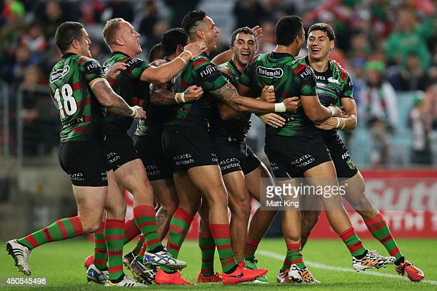 Kyle Turner of the Rabbitohs celebrates with team mates after scoring a try during the round 14 NRL match between the South Sydney Rabbitohs and the...