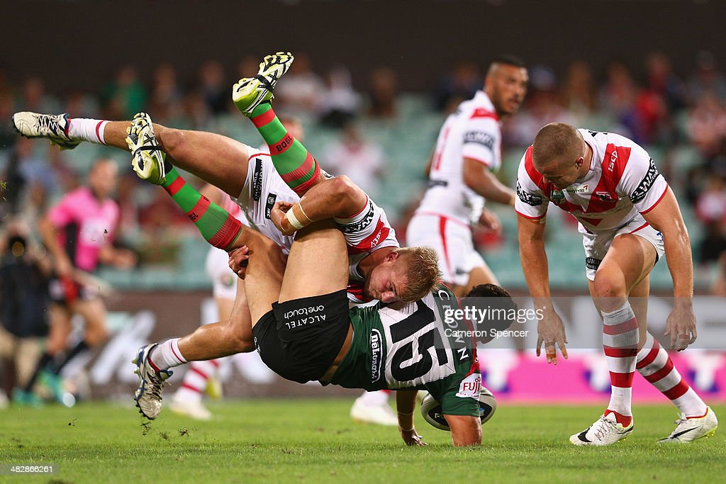 Kyle Turner of the Rabbitohs is tackled by Jack de Belin of the Dragons during the round five NRL match between the St George Illawarra Dragons and the South Sydney Rabbitohs at Sydney Cricket Ground on April 5, 2014 in Sydney, Australia.