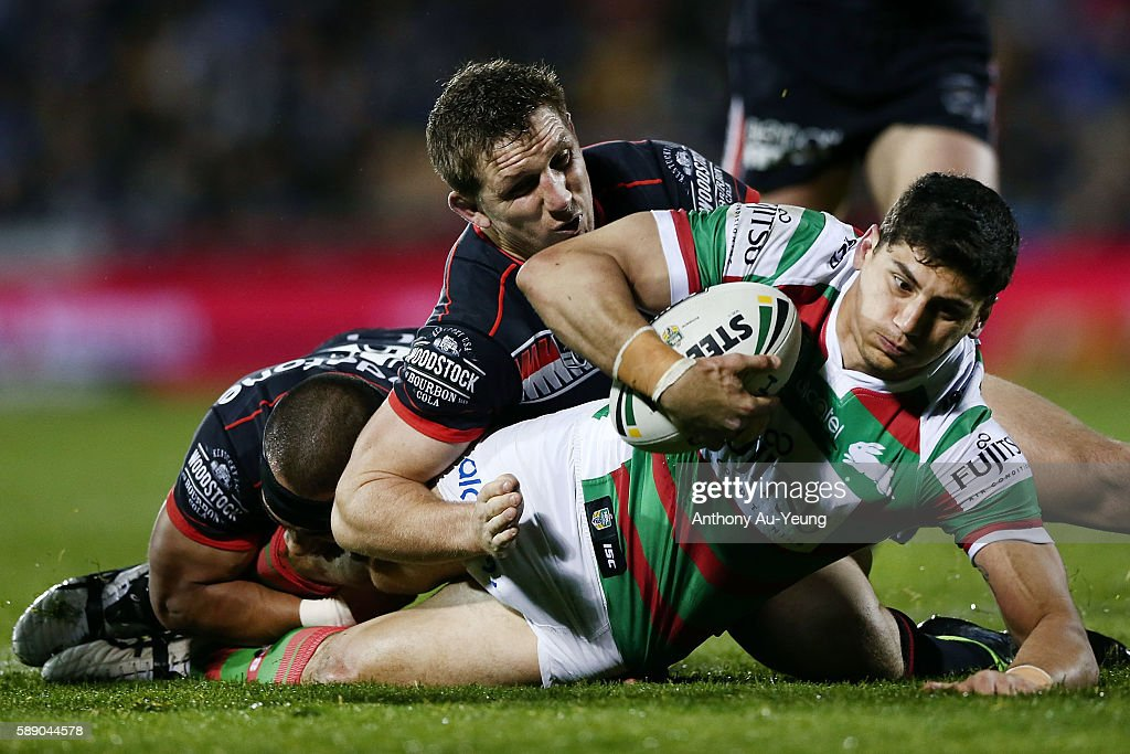 Kyle Turner of the Rabbitohs is tackled Ryan Hoffman of the Warriors during the round 23 NRL match between the New Zealand Warriors and the South Sydney Rabbitohs at Mount Smart Stadium on August 13, 2016 in Auckland, New Zealand.