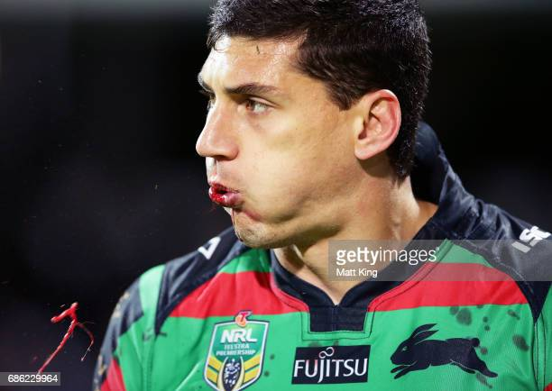Kyle Turner of the Rabbitohs spits blood during the round 11 NRL match between the South Sydney Rabbitohs and the Melbourne Storm at nib Stadium on...