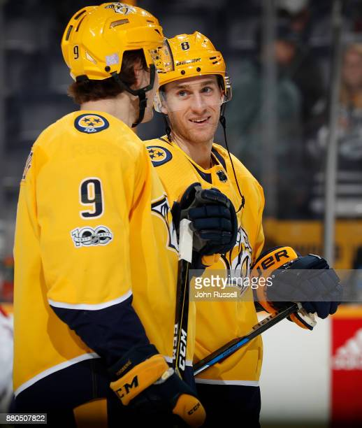 Kyle Turris and Filip Forsberg of the Nashville Predators skates in warmups prior to the game against the Montreal Canadiens at Bridgestone Arena on...
