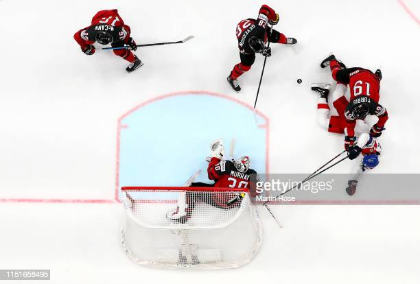 Kyle Turris of Canada challenges Tomas Zohorna of Czech Republic during the 2019 IIHF Ice Hockey World Championship Slovakia semi final game between...