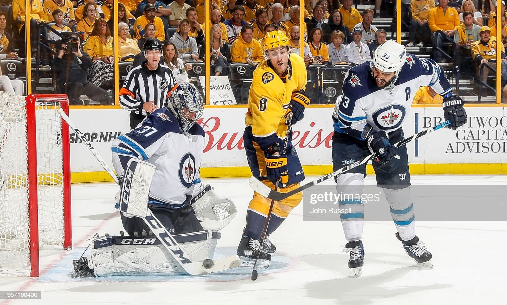 Kyle Turris #8 of the Nashville Predators battles between Connor Hellebuyck #37 and Dustin Byfuglien #33 of the Winnipeg Jets in Game Seven of the Western Conference Second Round during the 2018 NHL Stanley Cup Playoffs at Bridgestone Arena on May 10, 2018 in Nashville, Tennessee.