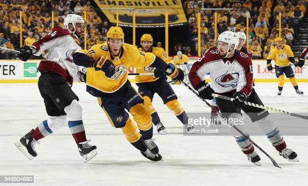 Kyle Turris of the Nashville Predators chases the puck between Mark Barberio and Alexander Kerfoot of the Colorado Avalanche in Game Five of the...